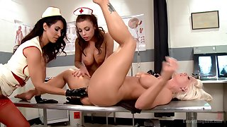 Nurses share a woman's warm pussy in magnificent lesbian trio