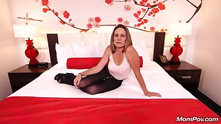 Skinny brunette milf with saggy tits, Judith, is riding a hard white bushwa for a camera