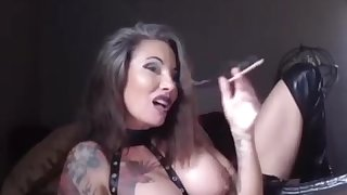 Busty tattooed dominant MILF smoking