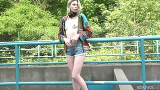 Skinny blonde solo chick Milena Devi enjoys playing in outdoors